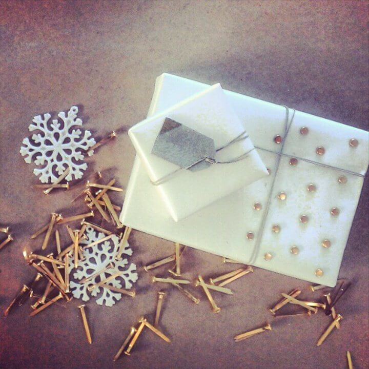 Brass brads can add texture to plain paper for a studded and sparkly look.