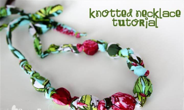 This Dupioni Silk Necklace Tutorial by Possibilities are Endless is very similar visually to the one I made. This one has a strand of seed beads overlapping the fabric wrapped beads, and a fabric tie closure.