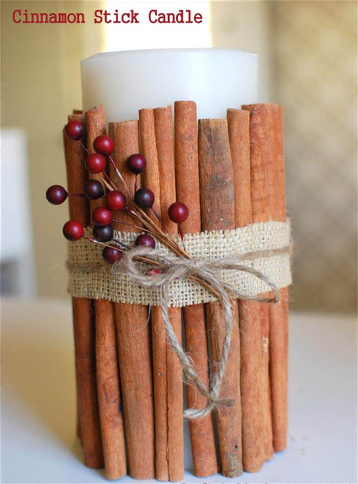 candle with cinnamon sticks