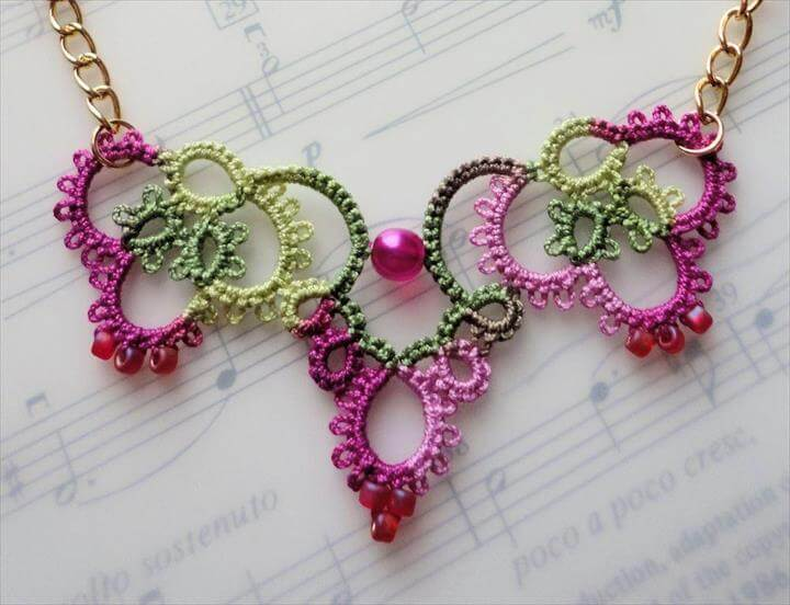 ochet jewelry pink crochet necklace laying on music book