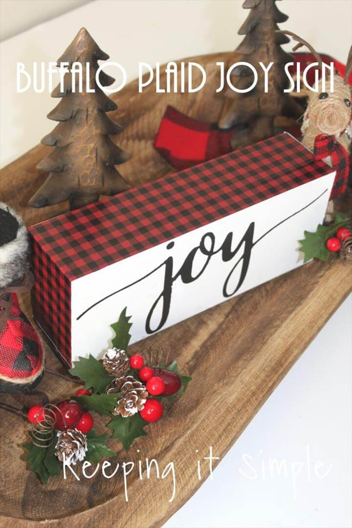 This red buffalo plaid Christmas joy block is super easy to make and looks amazing with lots of other fun Christmas decor.